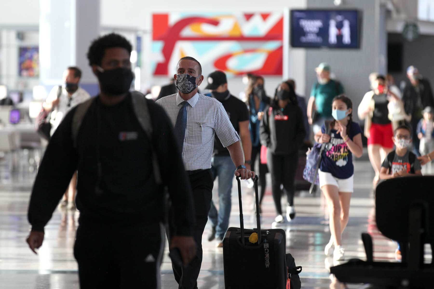 passengers walk through George Bush Intercontinental Airport