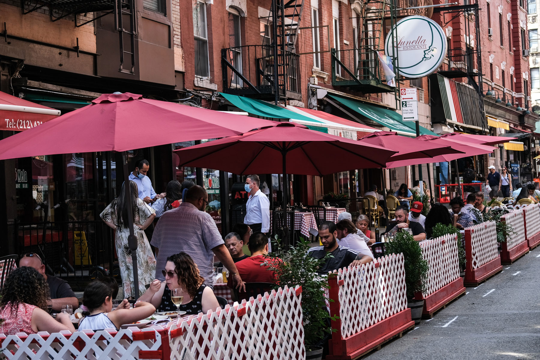 restaurant with outdoor seating on a street in Little Italy
