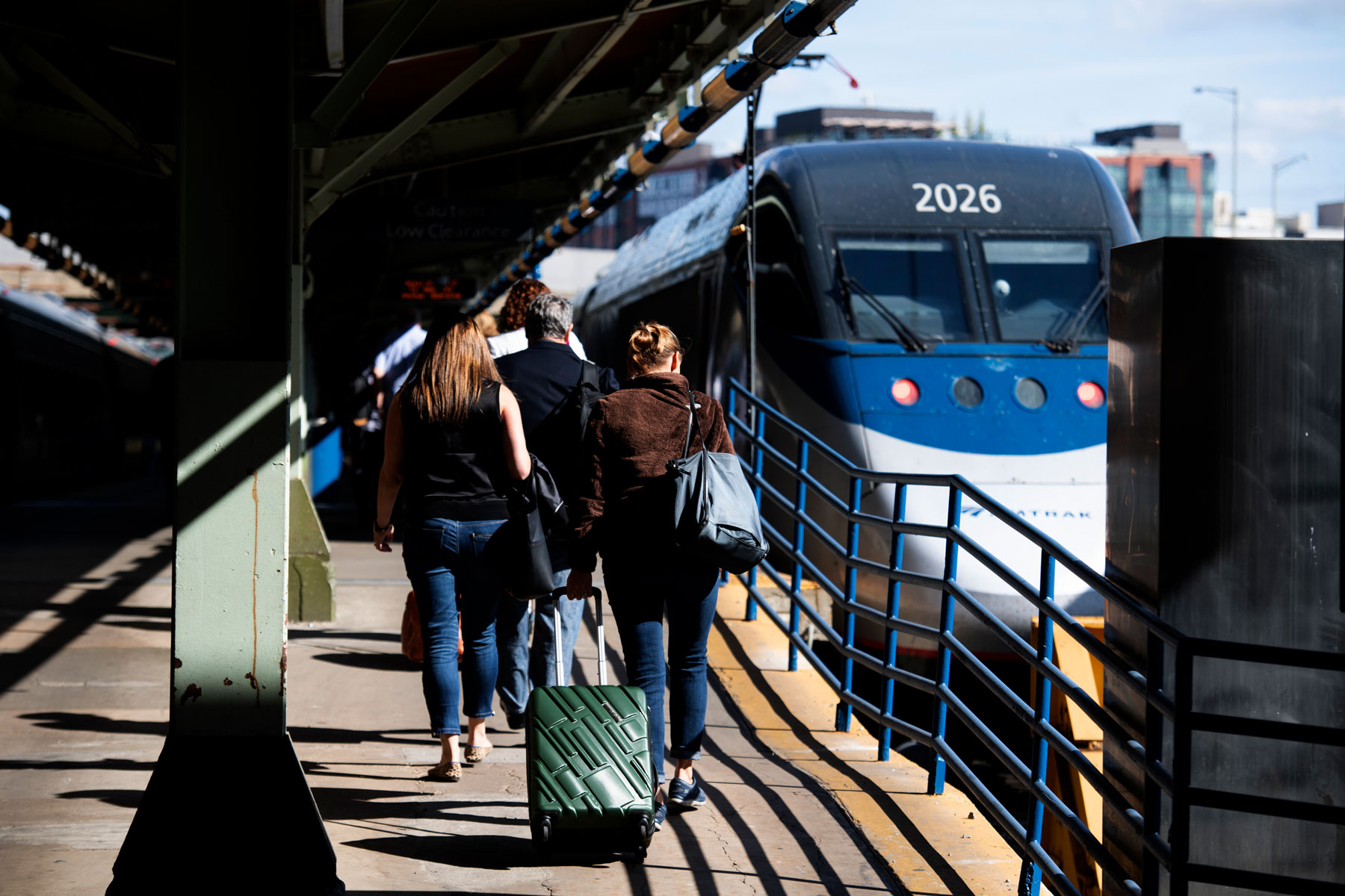 passengers walking toward an Amtrak train