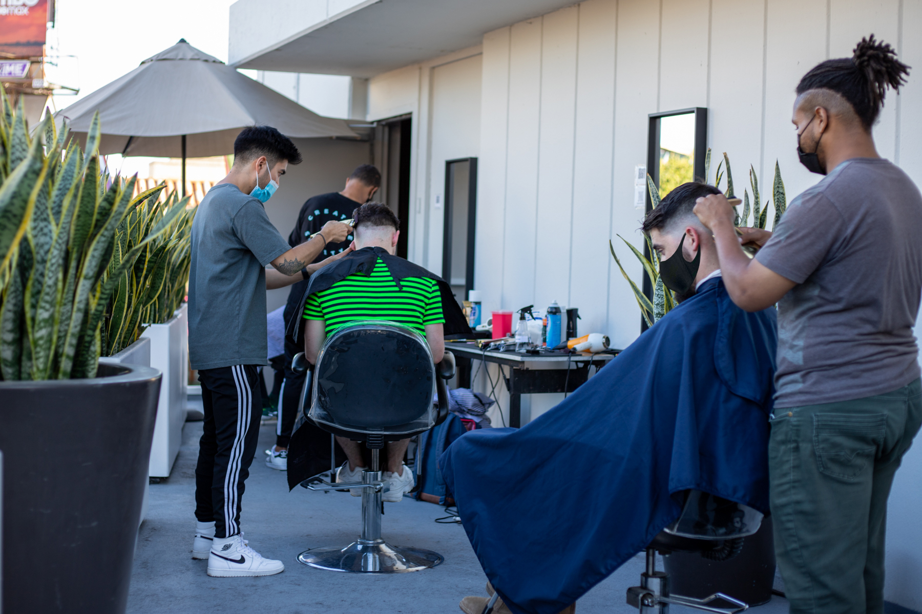 hair stylists serve customers on the rooftop of Andaz West Hollywood