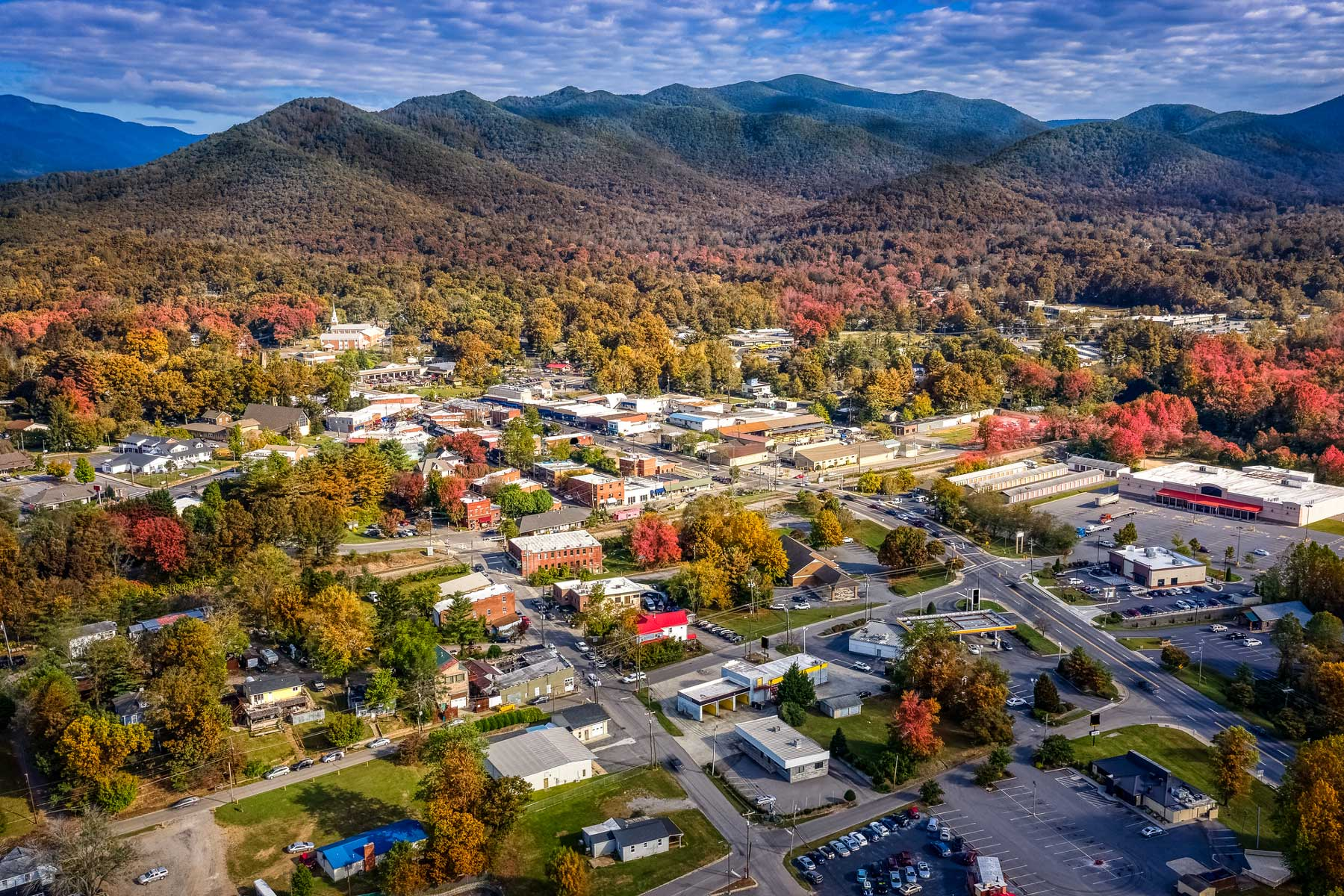 Aerial view picturesque Asheville neighborhood during the Fall with colors starting to show