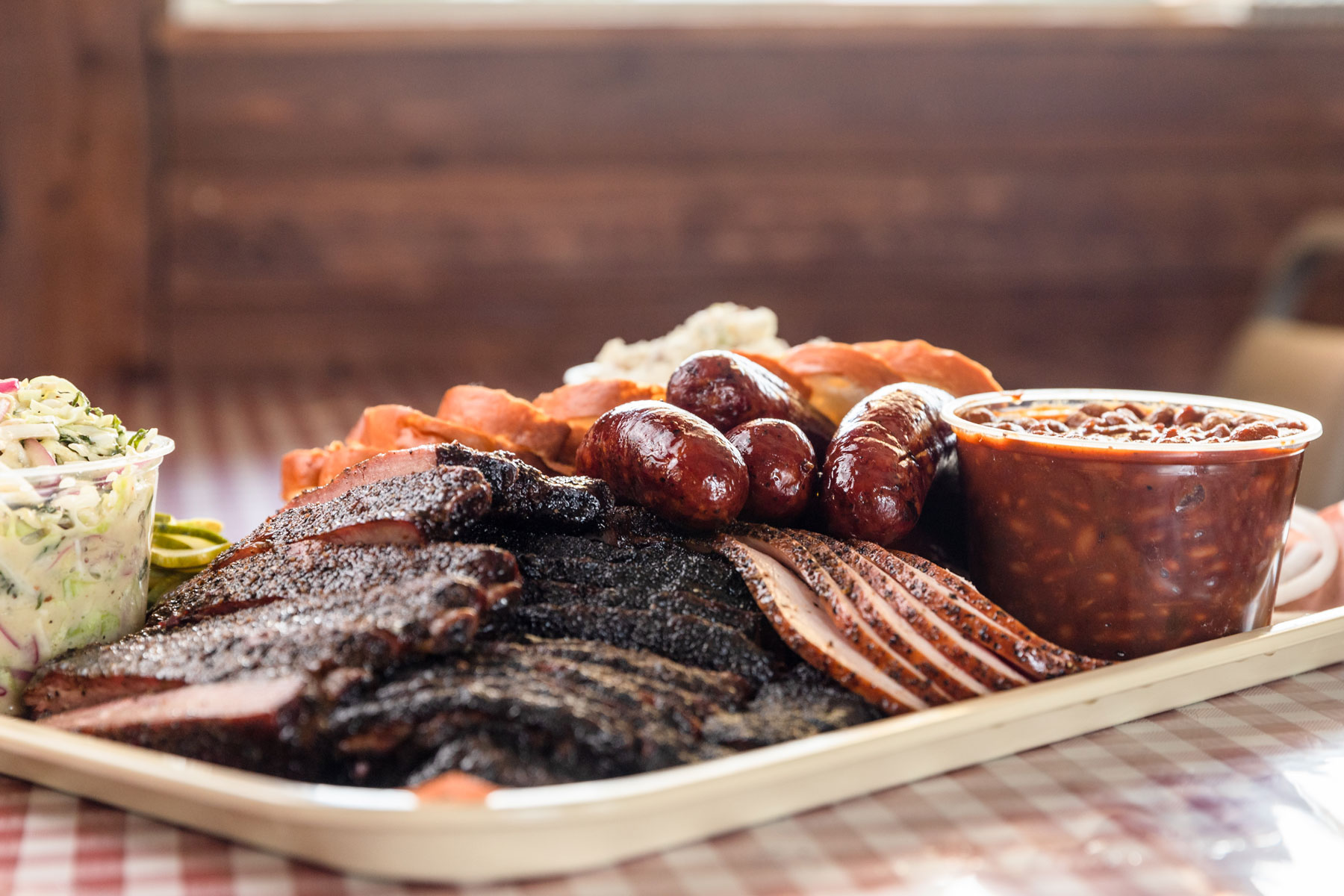Barbecue ribs, sausage, brisket, beans, and cole slaw