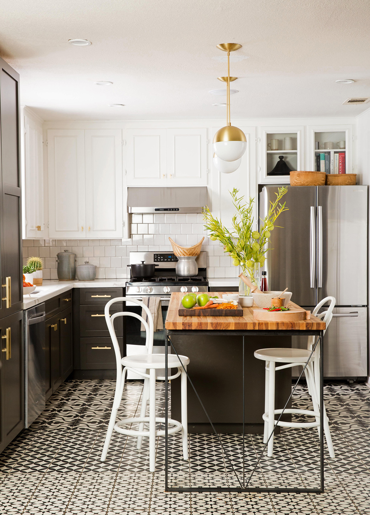 black and white kitchen with geometric tile floor