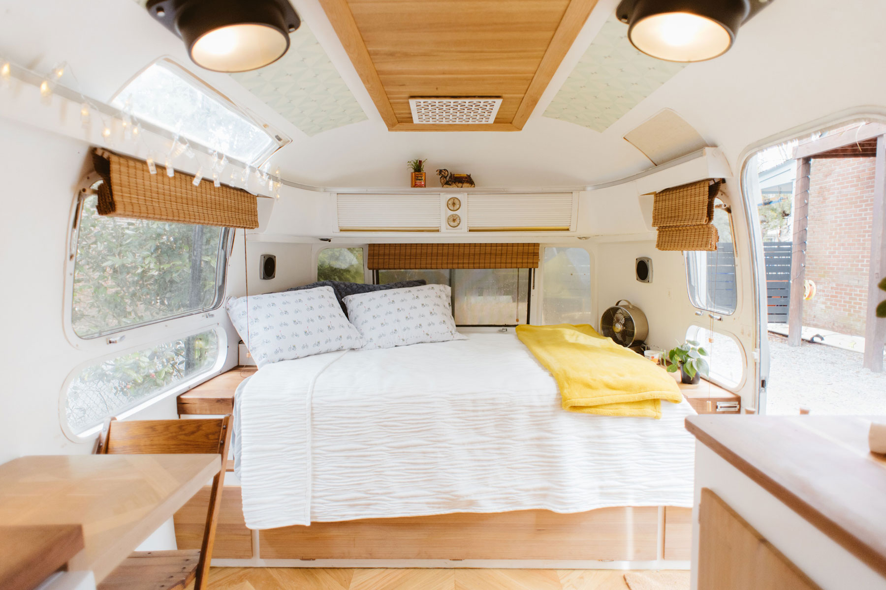 Bed and wooden accents in Airstream trailer