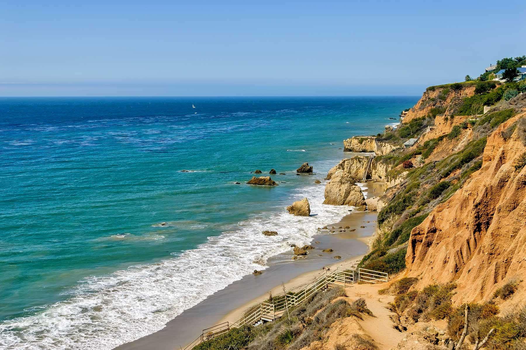 View of waves breaking in El Matador beach in Southern California