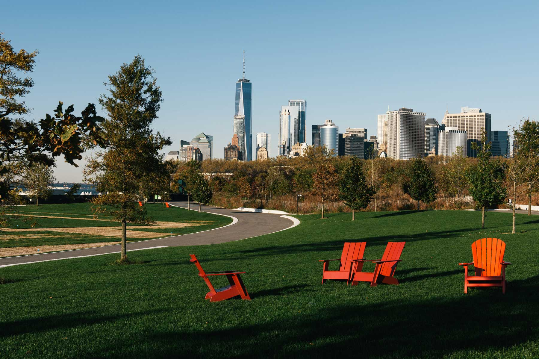 Chaise lounge chairs on the green lawn at Governors Island in NYC