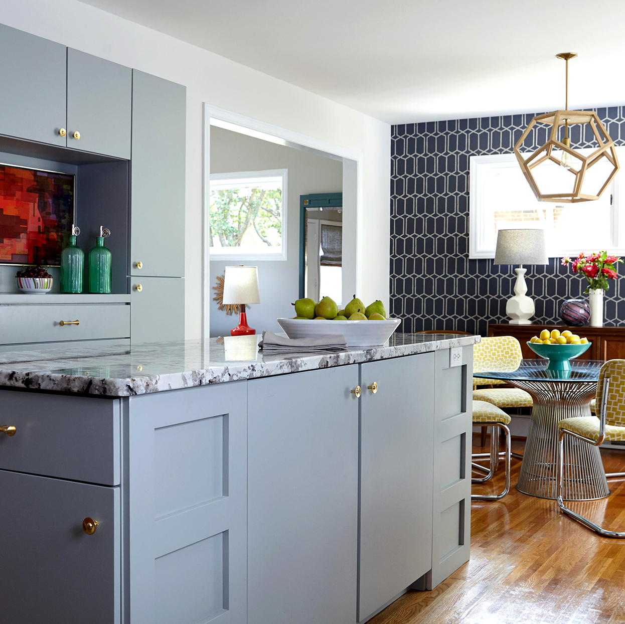 gray and white kitchen with red accents