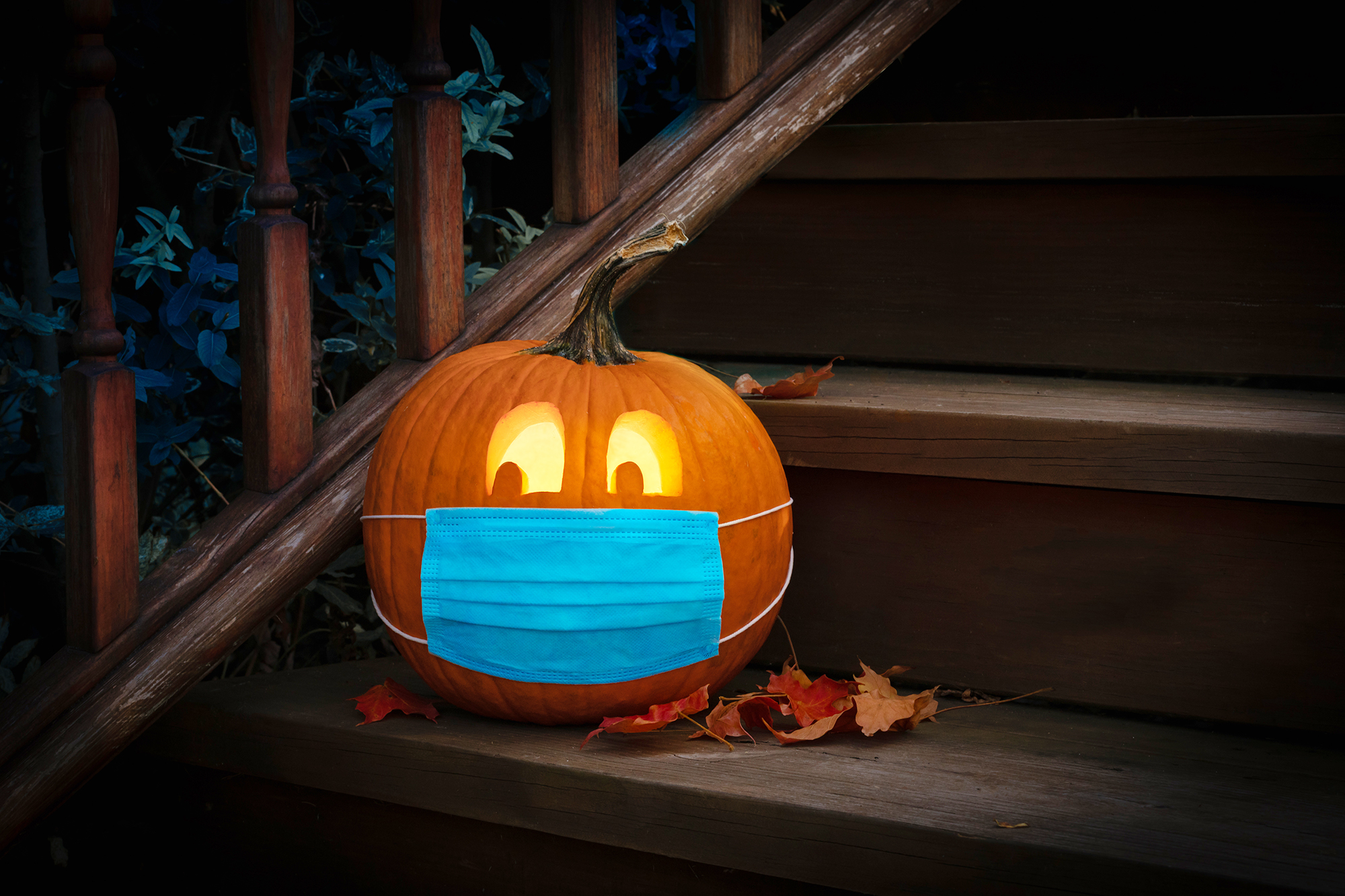 CDC Halloween Guidelines , Lighted Halloween Pumpkin Jack o Lantern Wearing Covid PPE Mask On Steps
