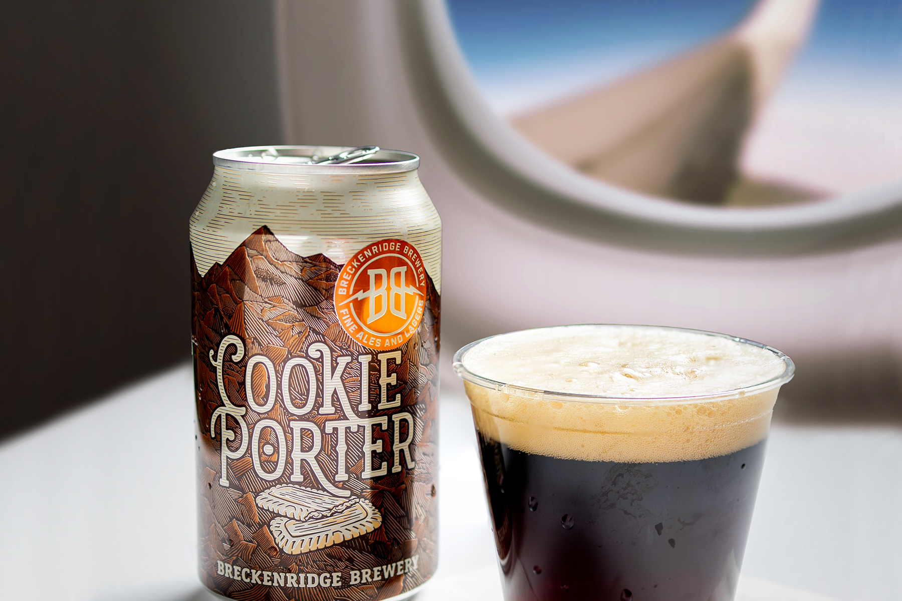 Breckenridge Cookie Porter Can and Cup on an airplane