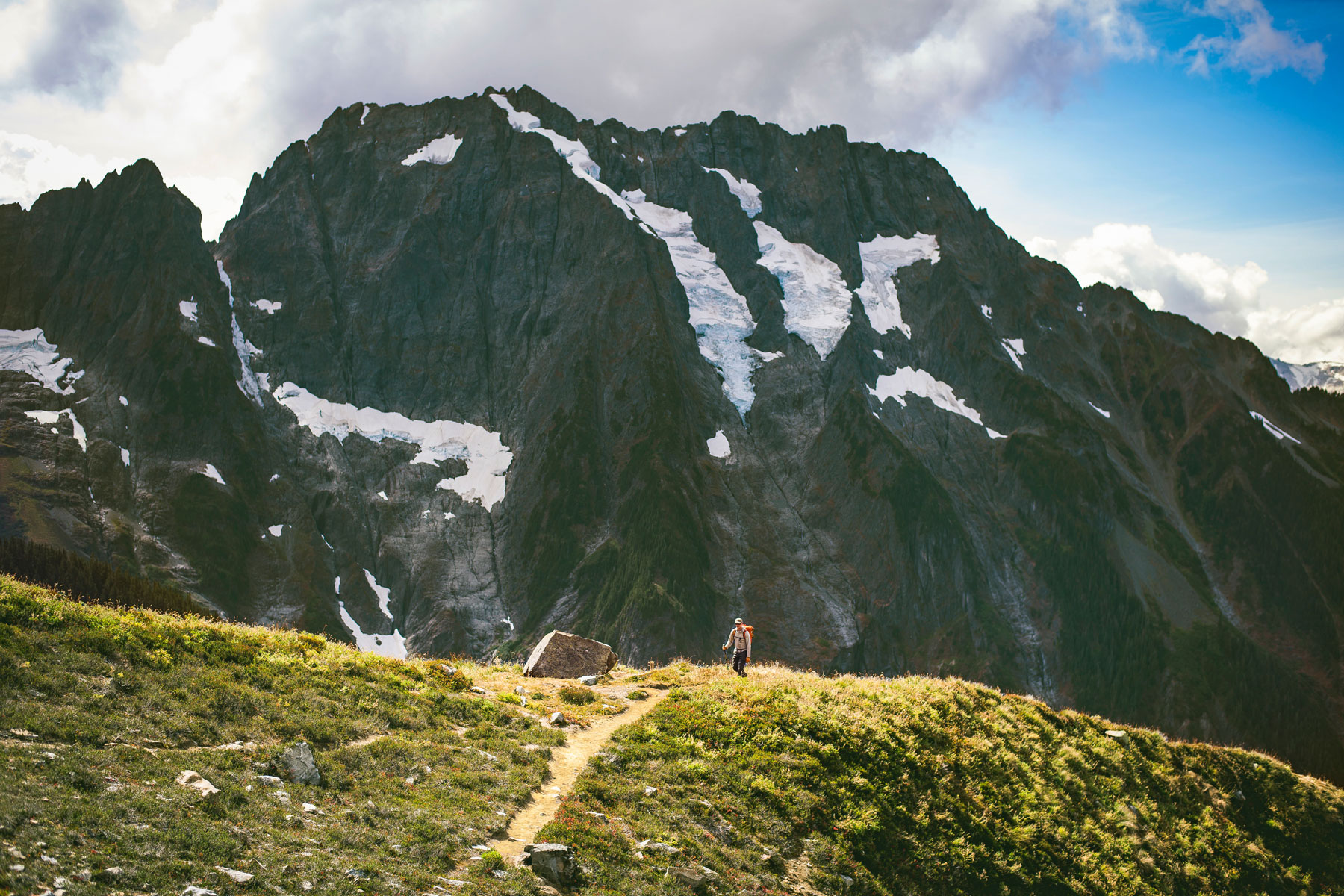 backpacker hiking on trail in North Cascades National Park