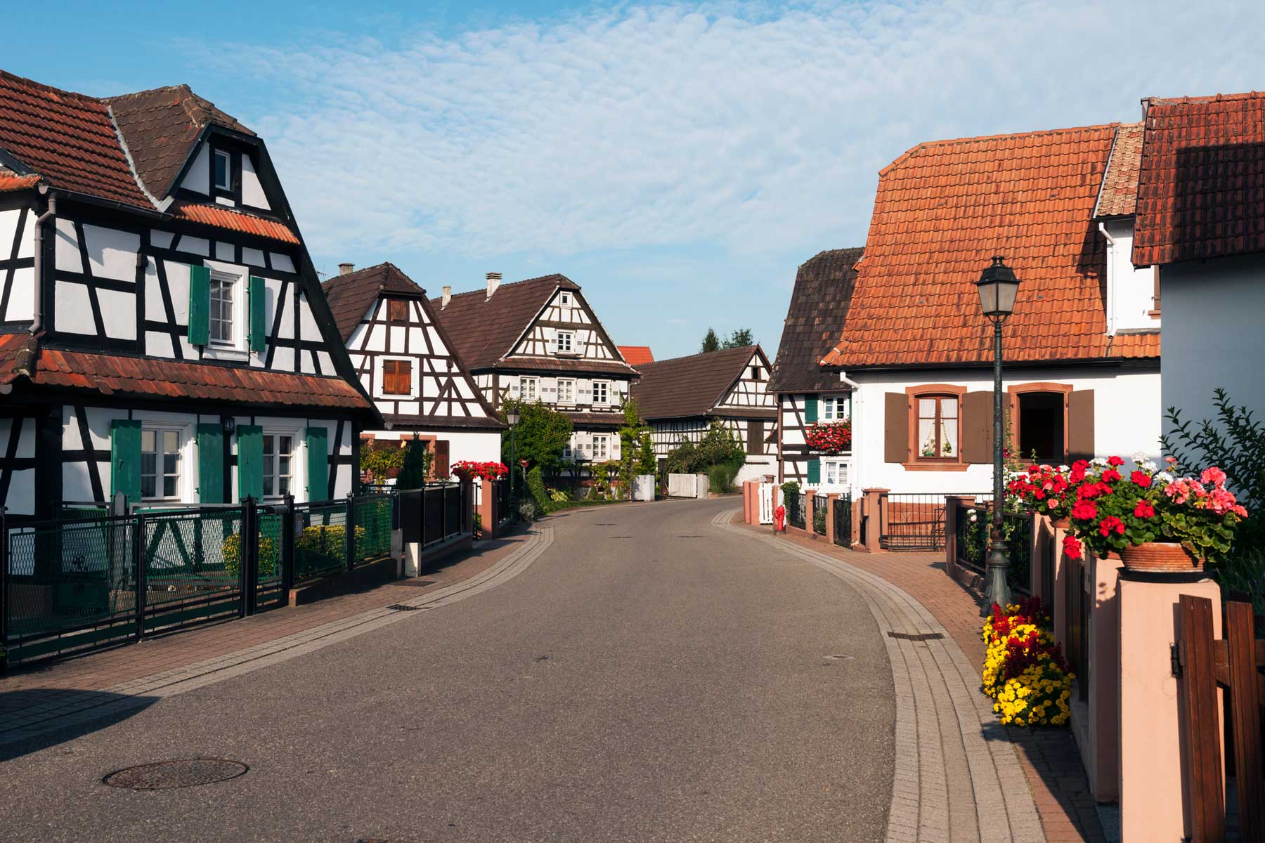France, Alsace, Hunspach, half-timbered houses on a curved road