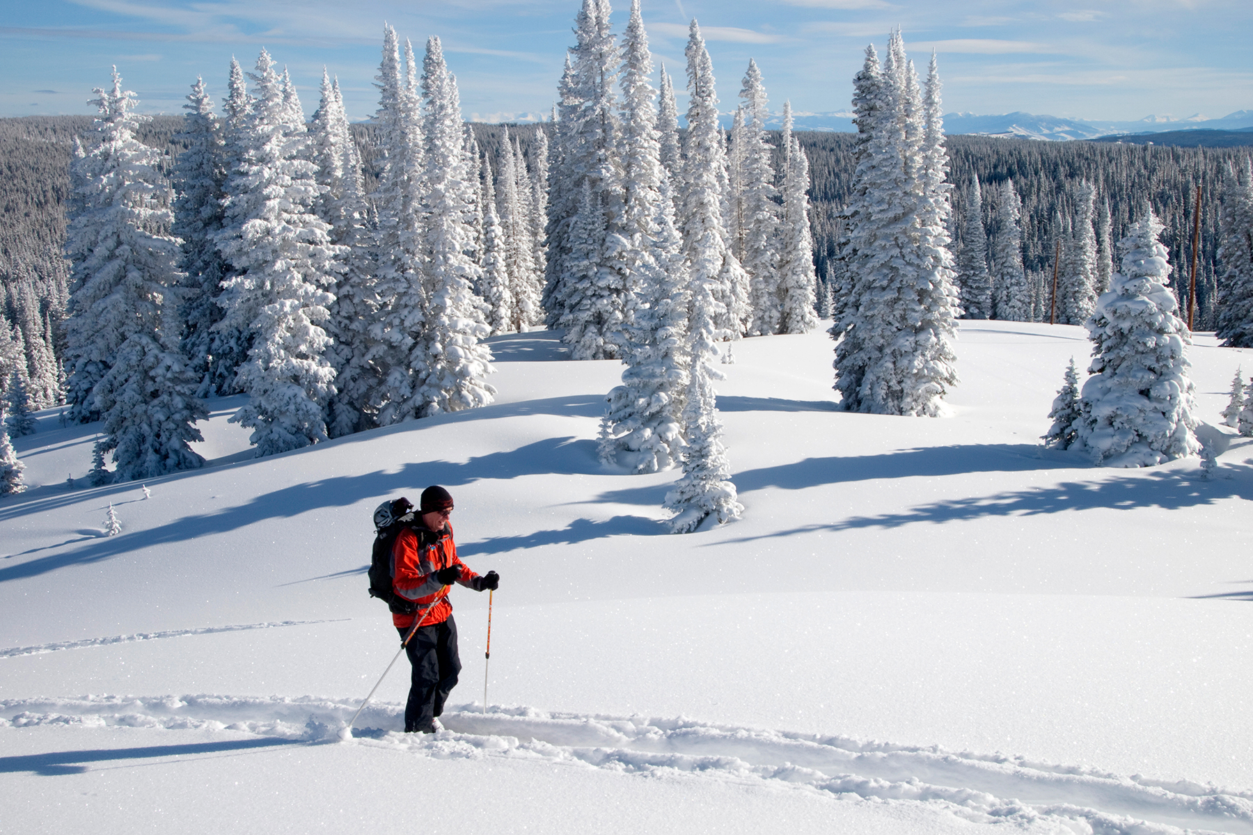Man Hiking On Snow Covered Mountain in Steamboat Springs