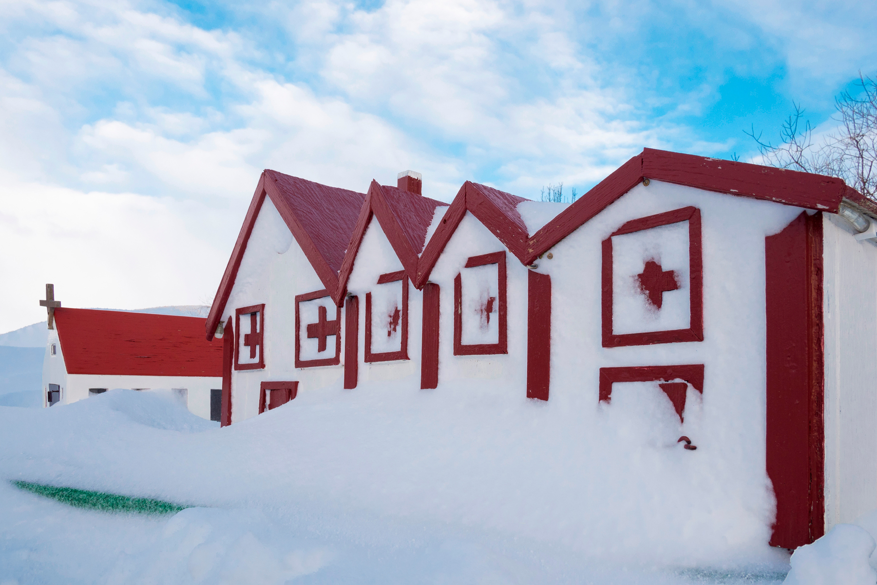 Typical elf houses near a traditional farm near Vik y Myrdal in Island during winter after a heavy blizzard