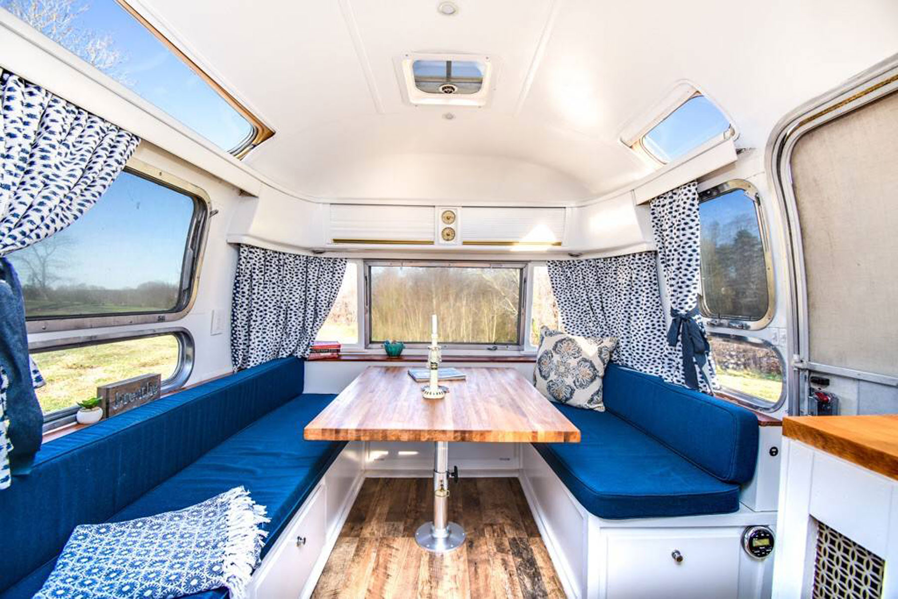 Dining table and booths in airstream trailer
