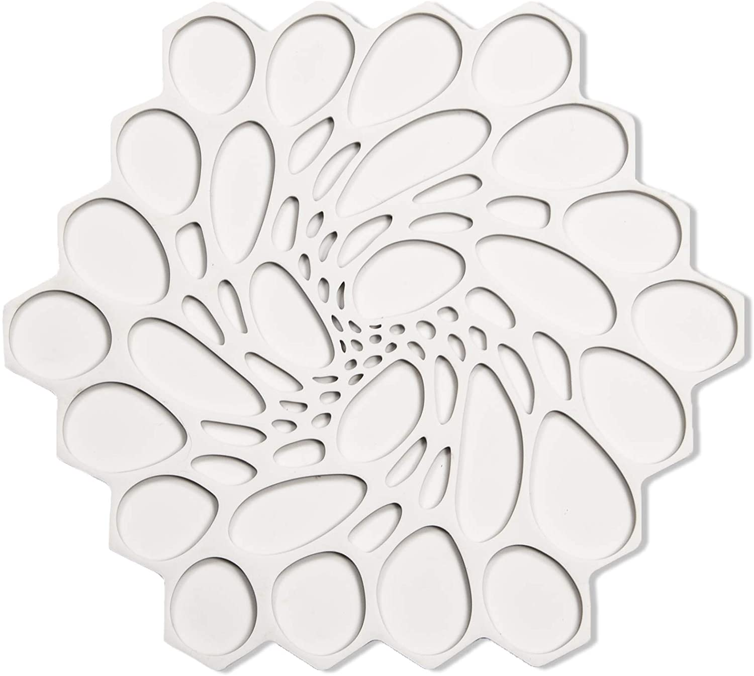 a creamy white modern twist silicone trivet on a white background