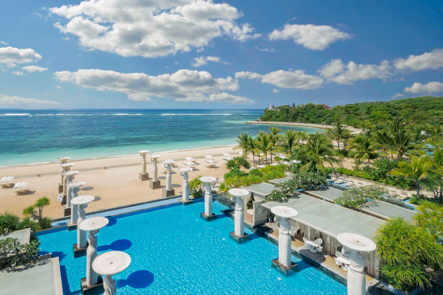 Pool and beach view of The Mulia in Bali