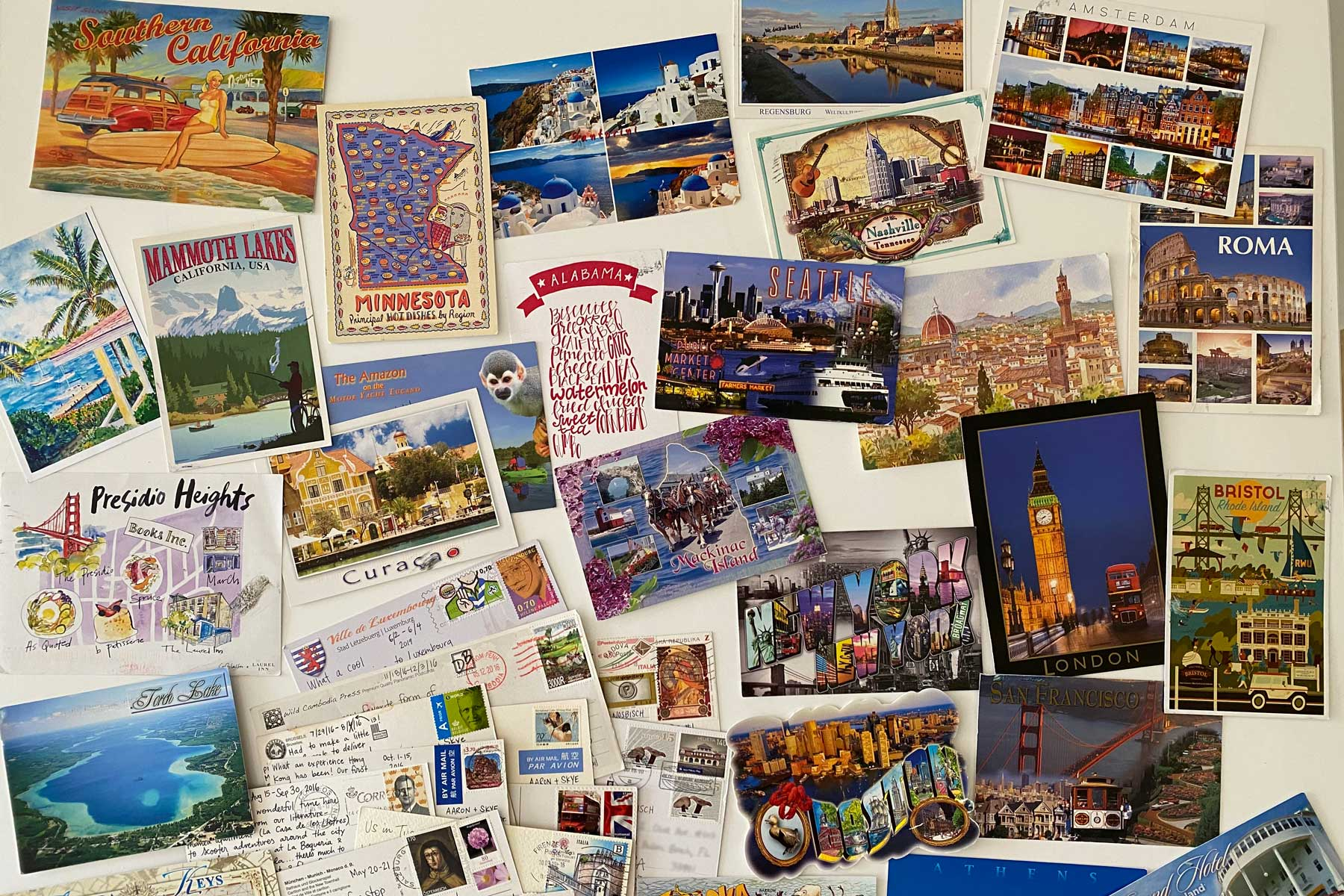 Postcards from around the world scattered together