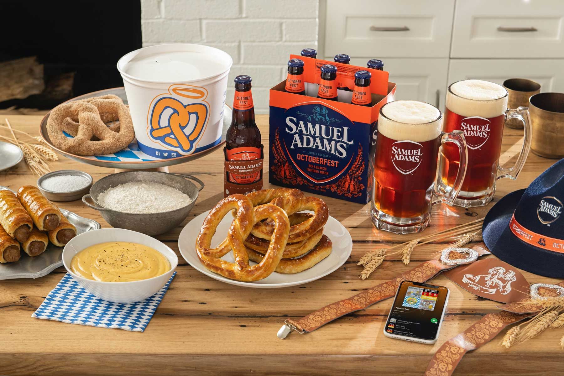 table with beer, pretzels, and Oktoberfest decorations