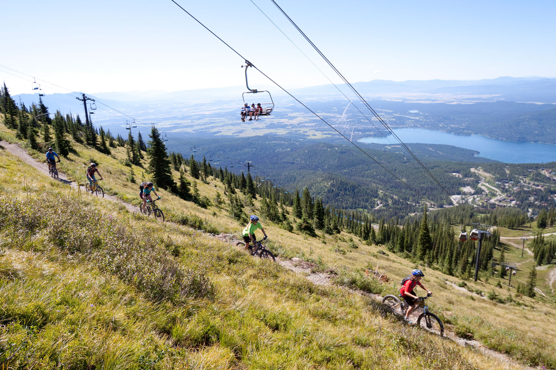 A family rides their bikes in Whitefish, Montana.
