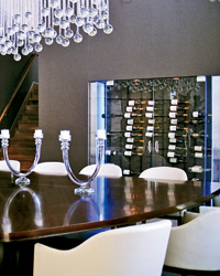 Storage in the dining room puts bottles in easy reach.