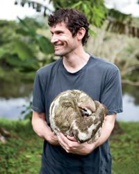 Chef Daniel Patterson holds a sloth.