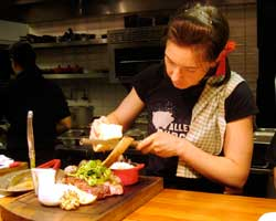 Top Chef Canada's Chef Connie DeSousa putting the finishing touches on a Stampede steak special.