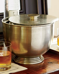 Pottery Barn's new bar rools -- like this brass-and-steel bucket -- recall old silverware.