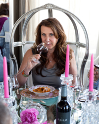Gina Gallo tries her Pinot Noir with the pasta.