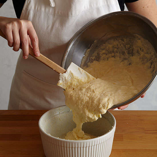 How to Make Cheese Soufflé: Scrape into dish