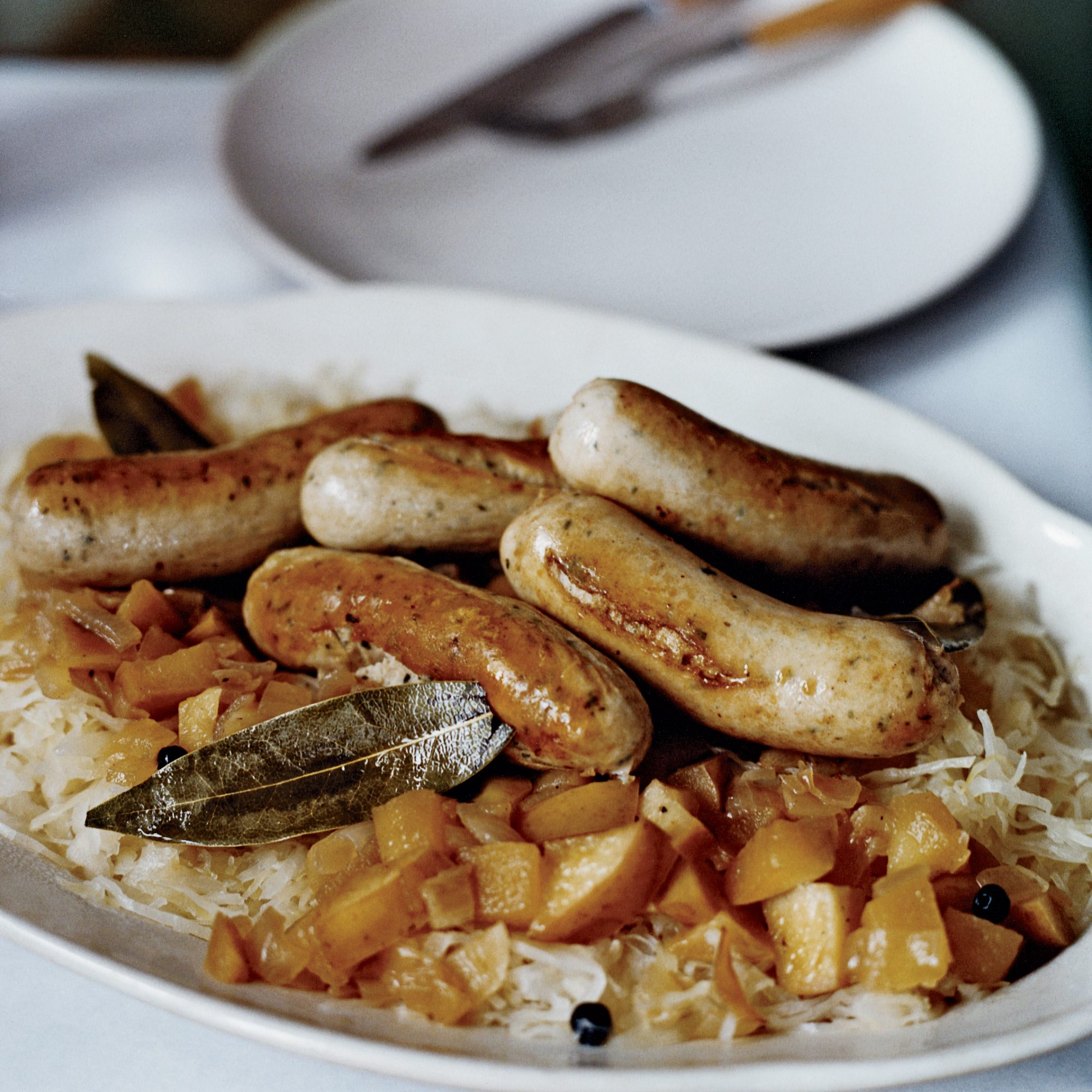 Sautéed German Sausages with Bacon and Apple Sauerkraut