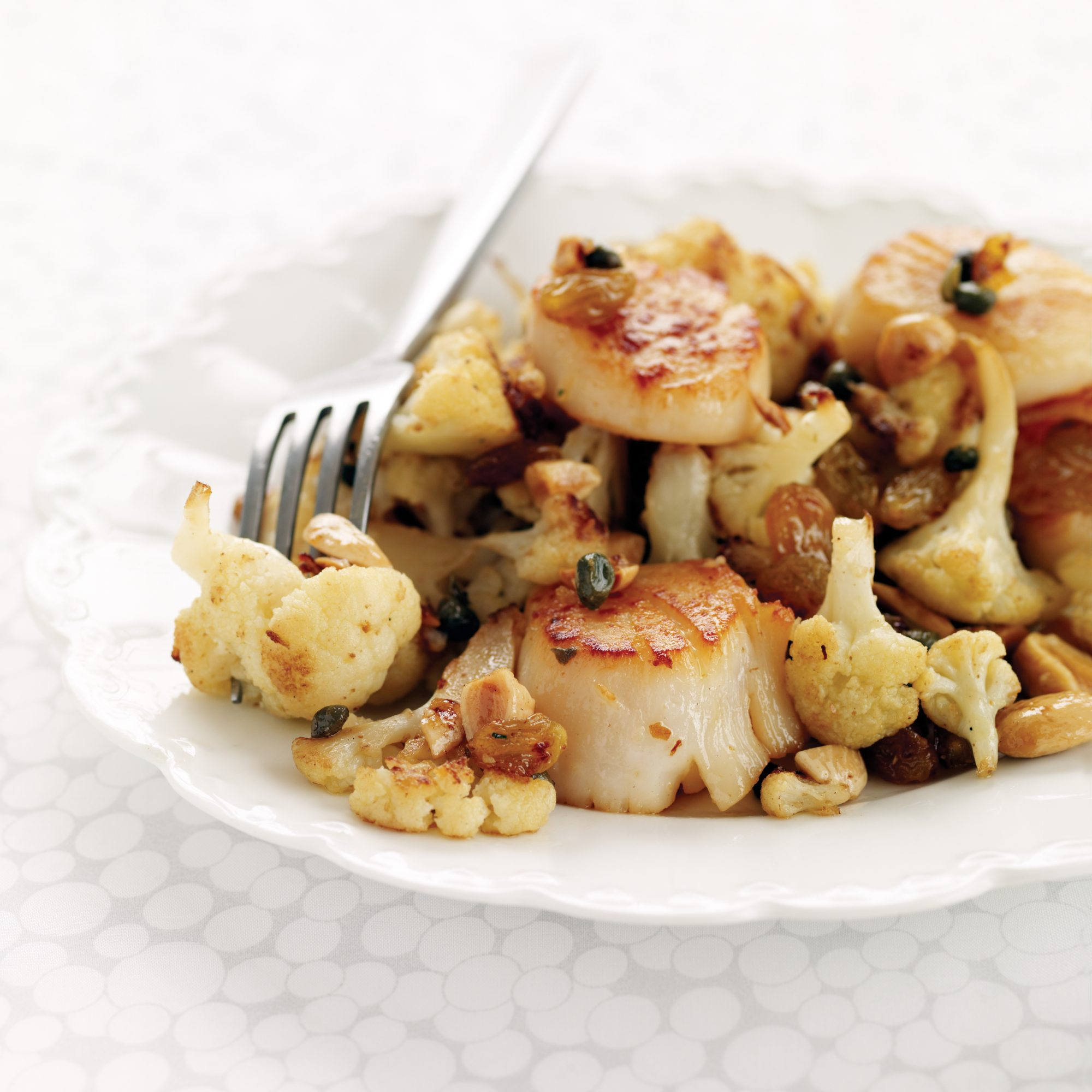 Seared Scallops with Cauliflower, Capers and Raisins