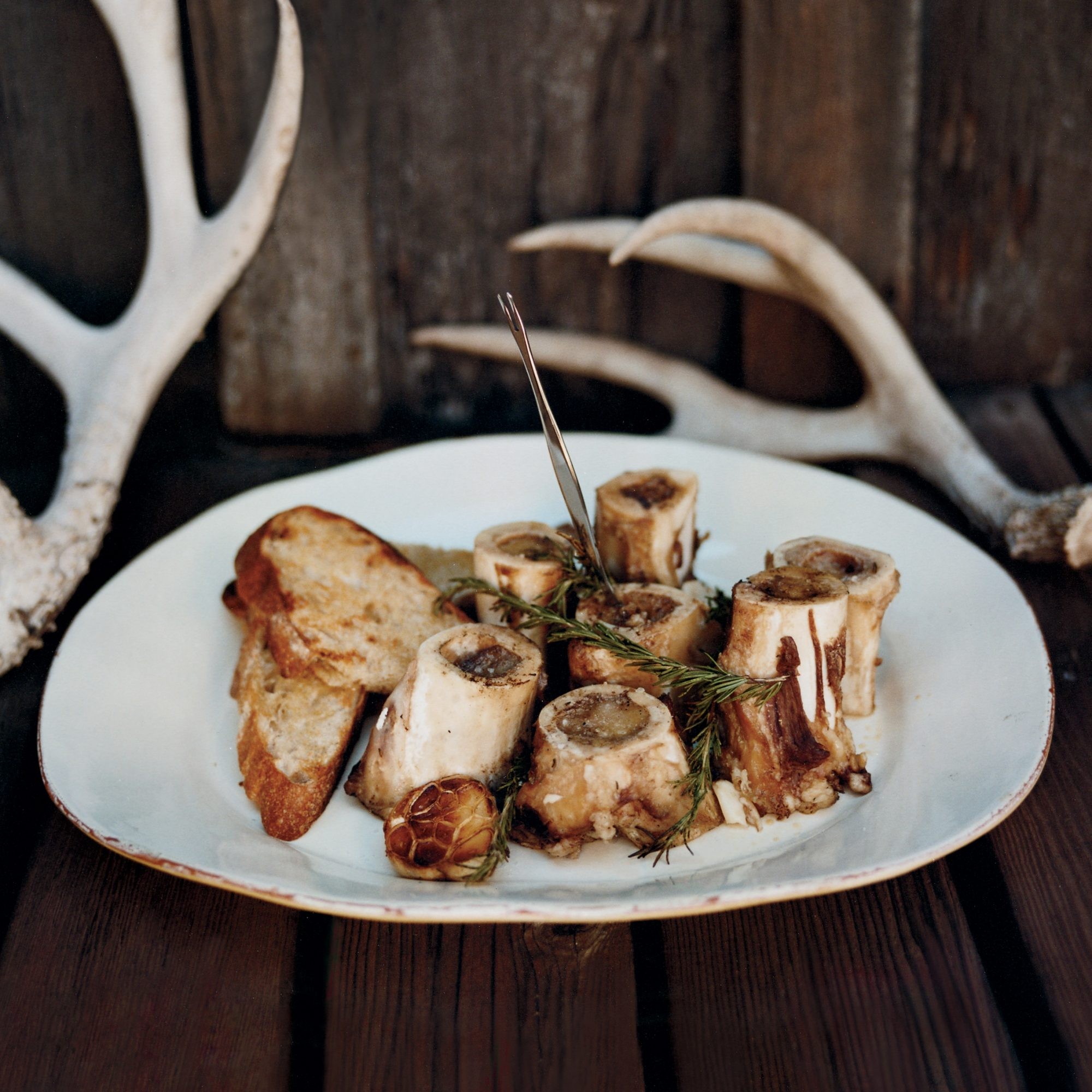 Grilled Marrow Bones with Rosemary-Lemon Bruschetta