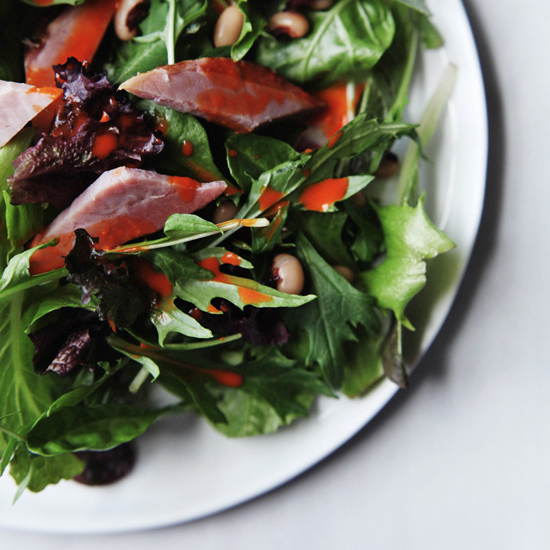Mixed Greens with Smoked Ham, Black-Eyed Peas, and Roasted-Red-Pepper Dressing