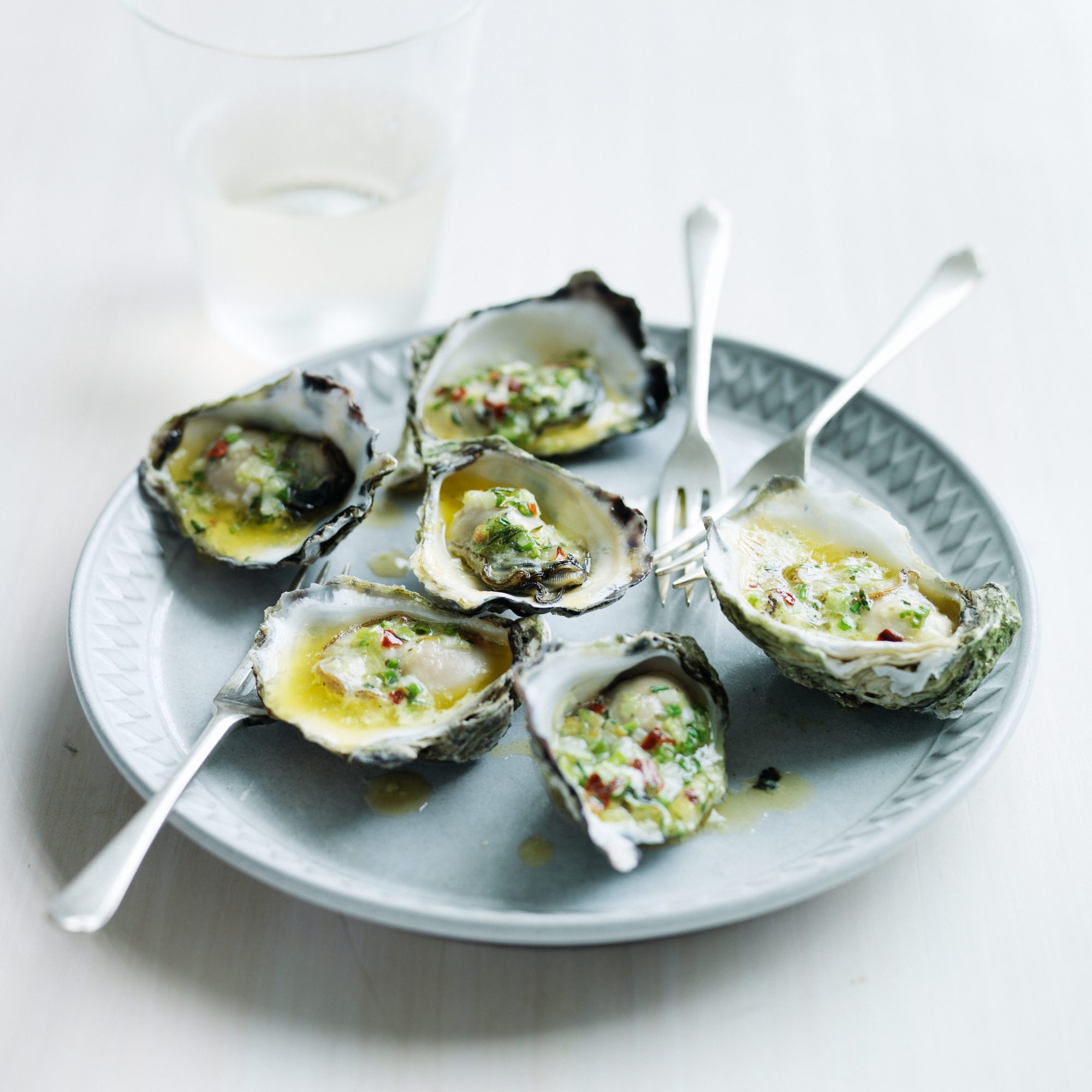 Fire-Grilled Oysters with Green Garlic and Pastis Butter