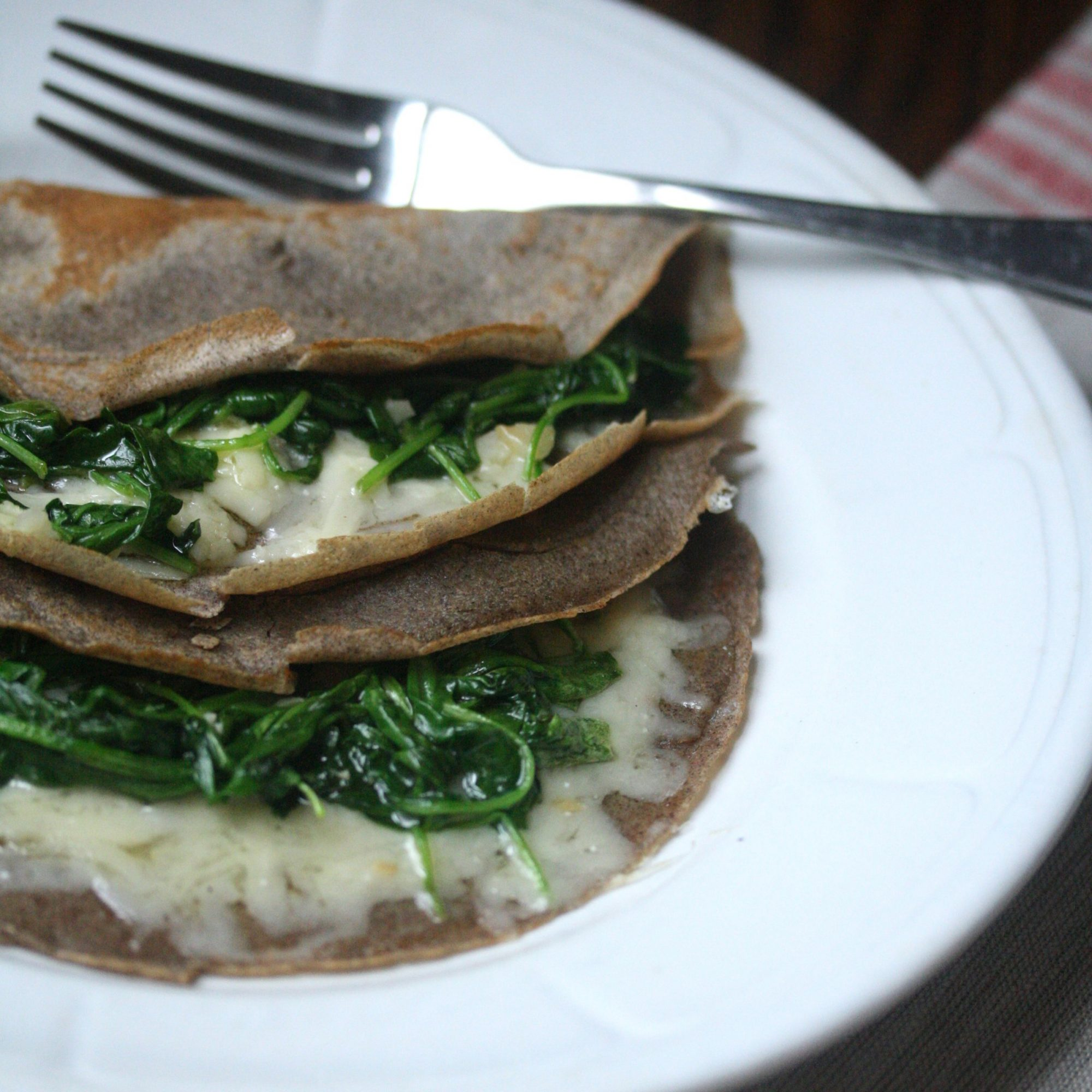 Buckwheat Crêpes with Wilted Arugula and Cheddar