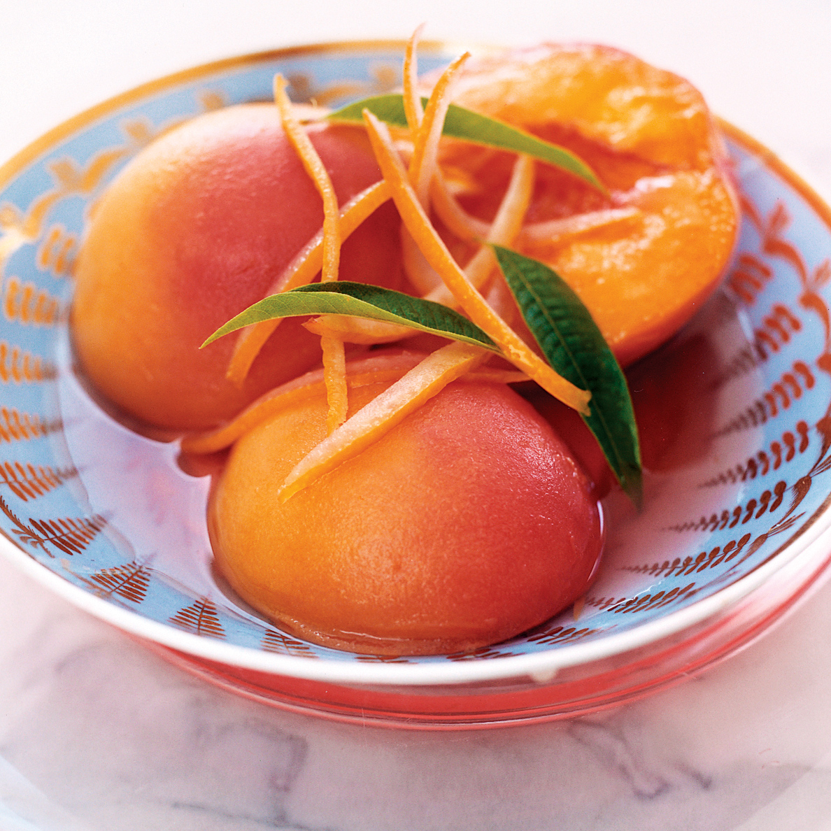 Muscat-Poached Peaches with Lemon Verbena