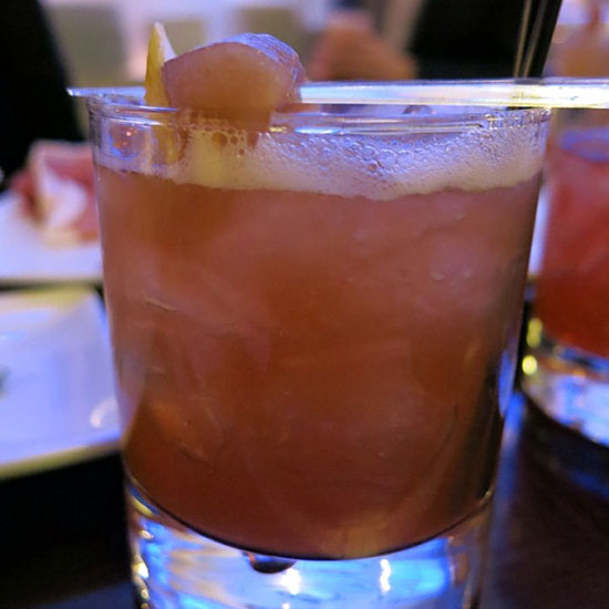 Red Jacket Cocktail with Macerated Apple Garnish