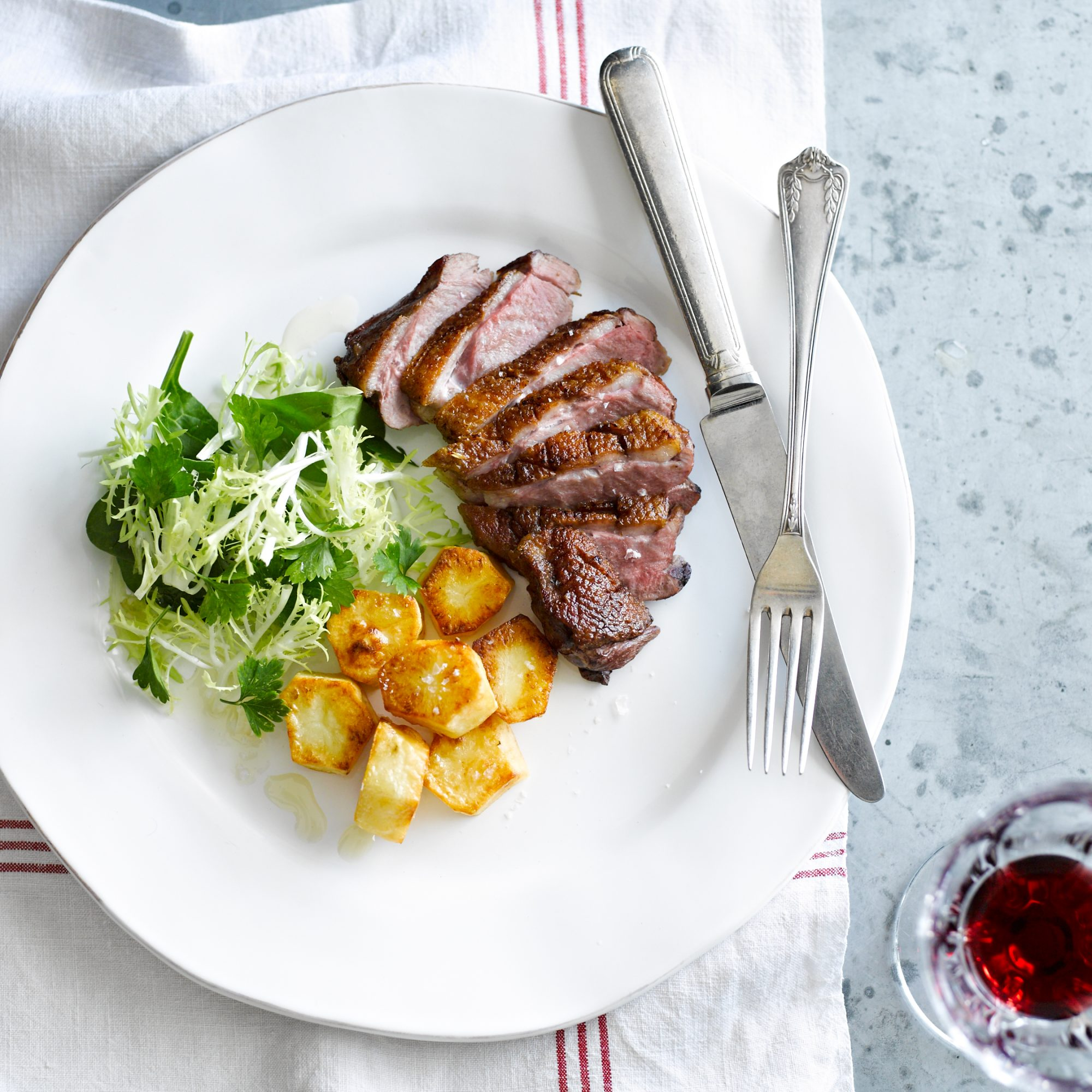 Duck Breasts with Crispy Potatoes and Frisée Salad