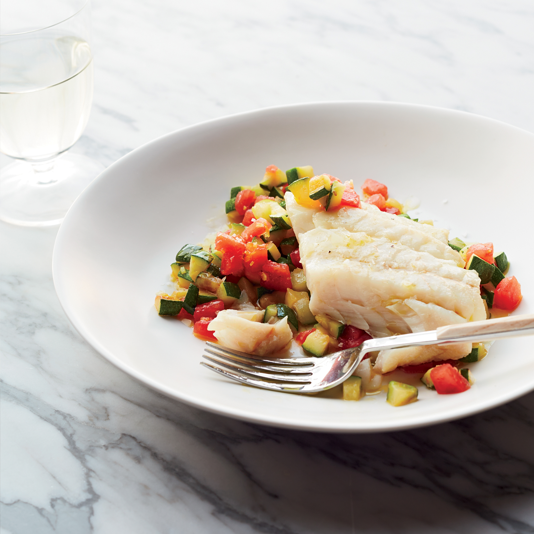 Olive Oil-Poached Hake on Sautéed Zucchini with Tomatoes
