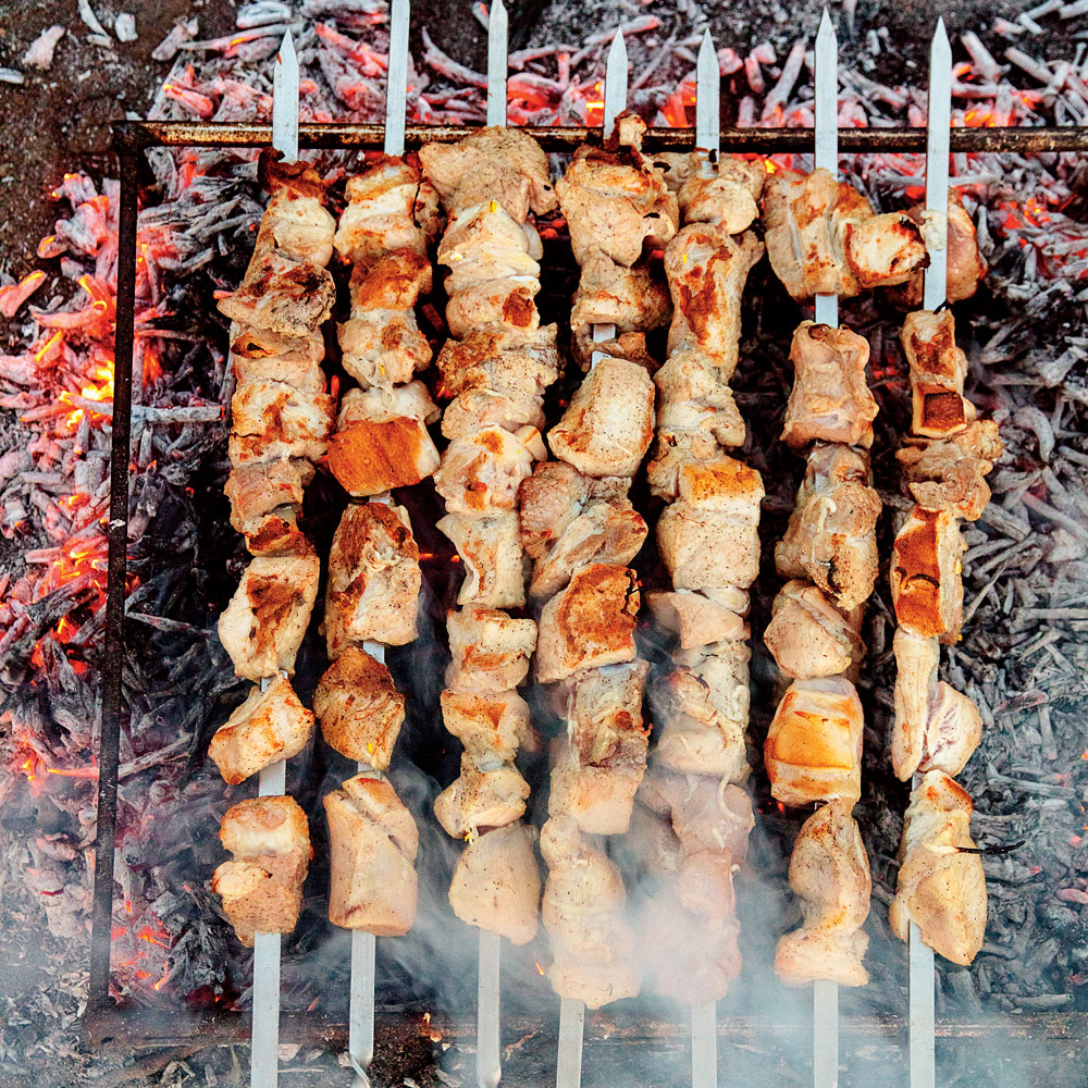 Mtsvadi (Grilled Pork Skewers with Pomegranate and Onions)