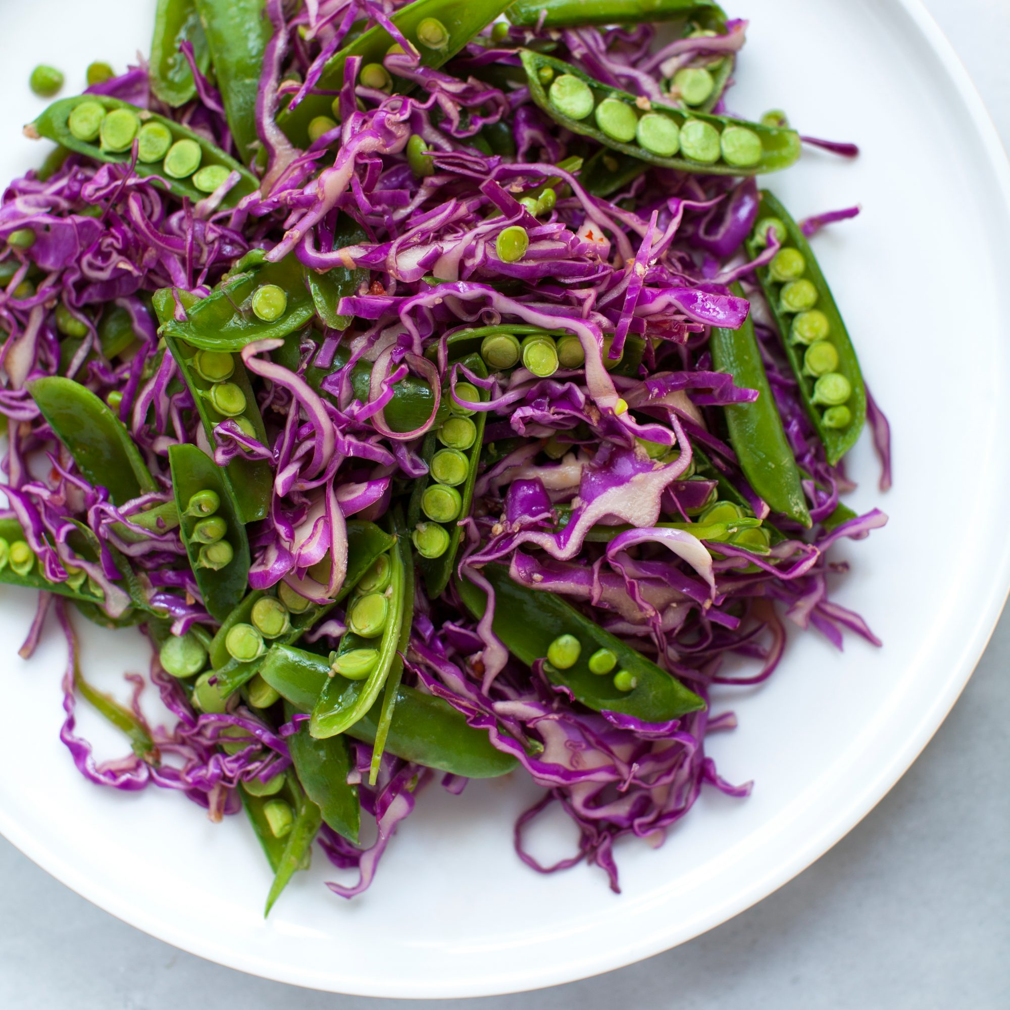 Red Cabbage and Sugar Snap Pea Slaw with Sesame-Ginger Dressing
