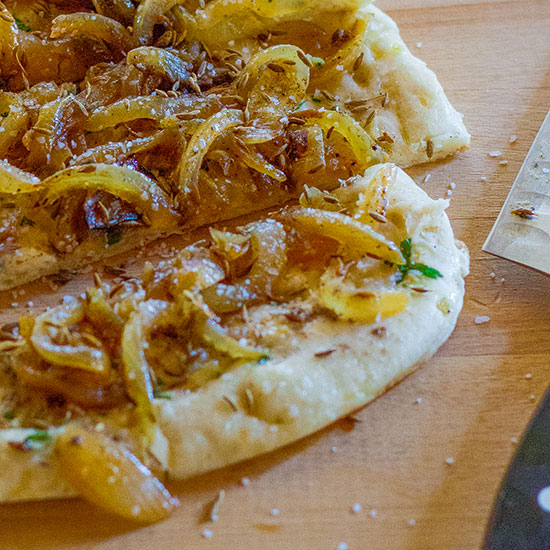 Fresh-baked Naan with Cumin and Caramelized Onion