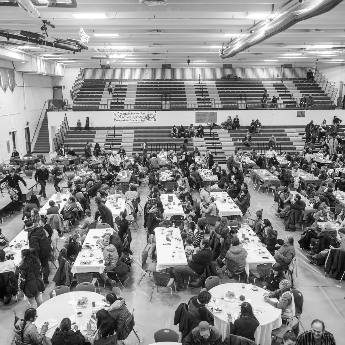 Dinner in the gymnasium at Wopila Feast Brigade's Thanksgiving dinner.