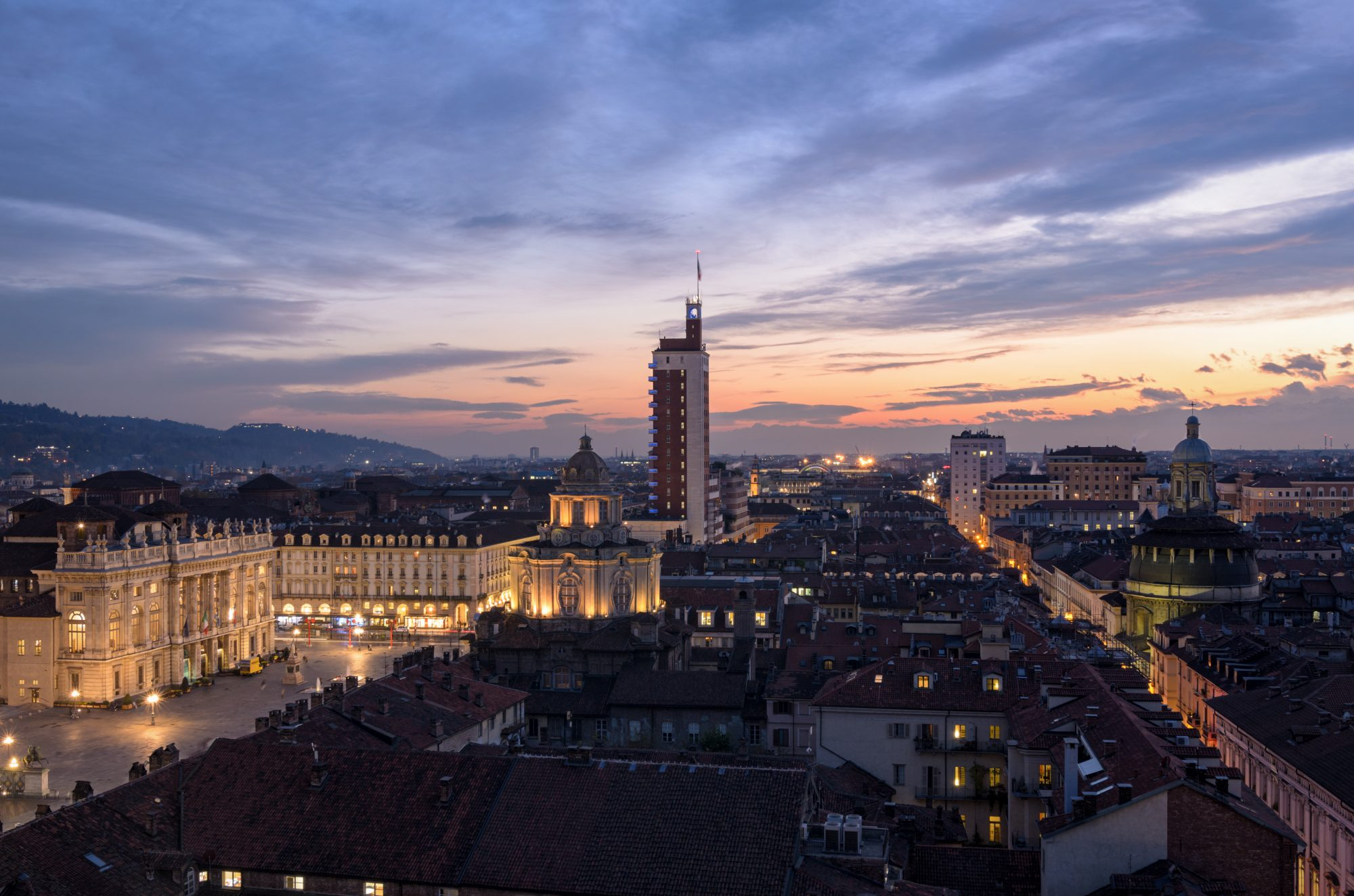 Turin (Torino) panoramic view on Piazza Castello from the Cathedral bell tower at sunset