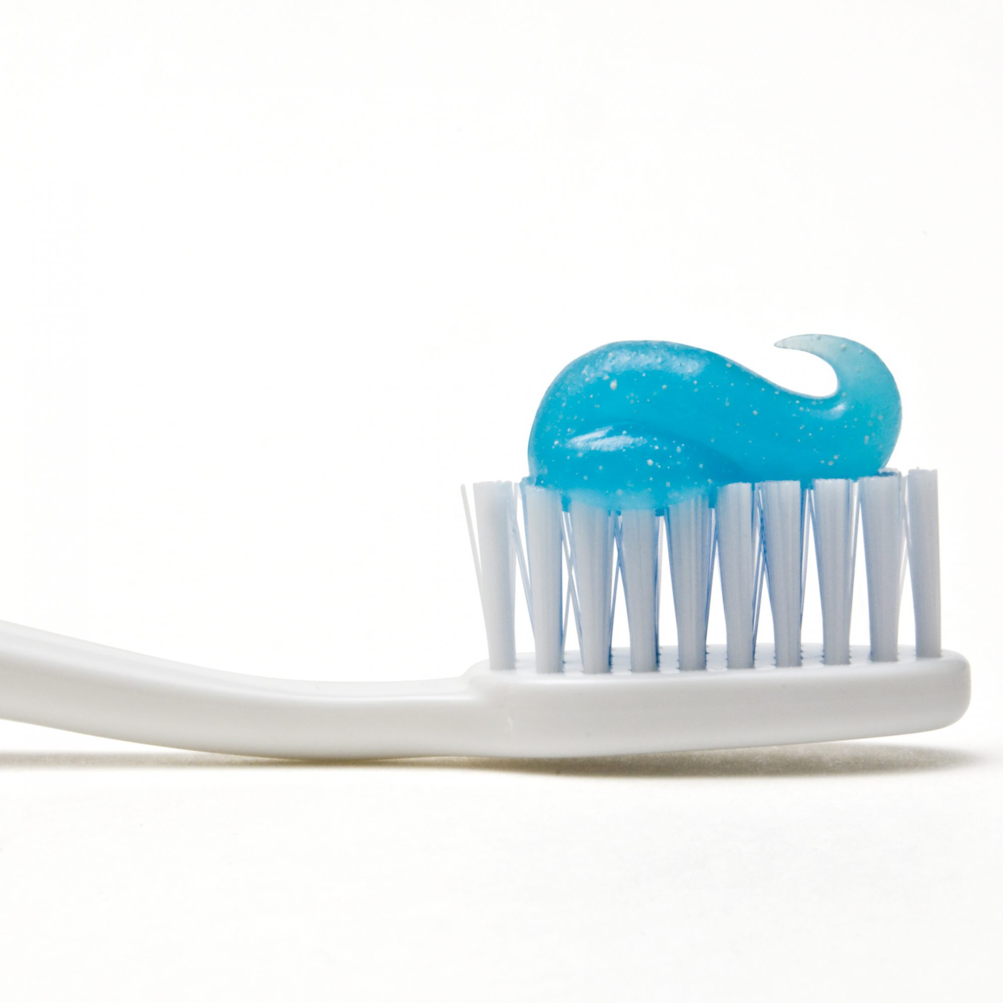 tooth-paste-on-toothbrush-fwx