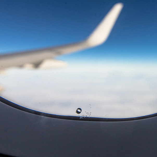 What that tiny hole in the airplane window does