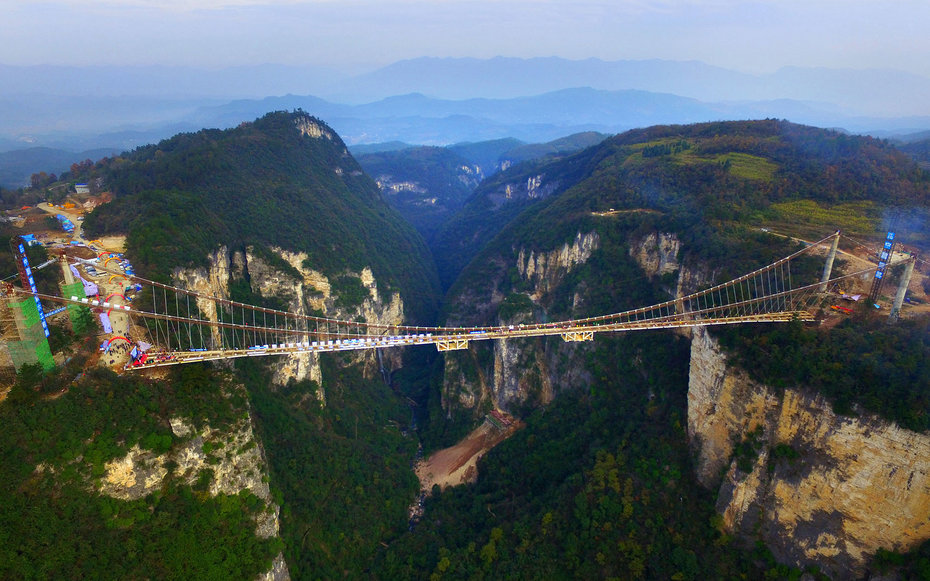 (CHINA OUT) An aerial view of the glass-bottom bridge with steel beams completed at Tianmenshan National Forest Park on December 3, 2015 in Zhangjiajie, Hunan Province of China. World's longest glass-bottom bridge betwee