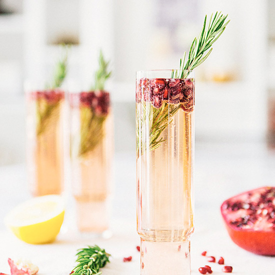 FWX DOMAINE HOME CHRISTMAS COCKTAILS POMEGRANATE ROSEMARY SPRITZER
