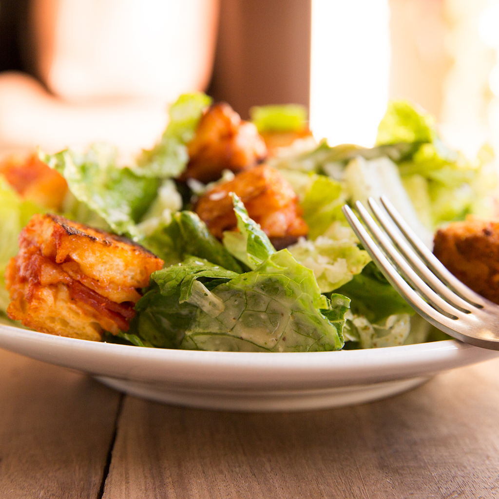 FWX KITCHEN TRASH PIZZA CROUTONS IN SALAD