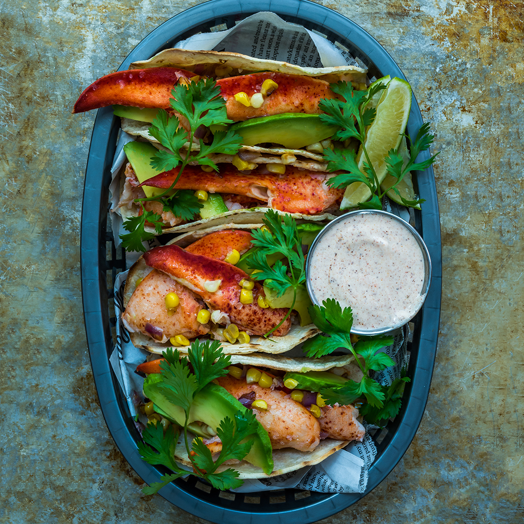 Lobster Tacos with Fresh Corn, Avocado, and Spiked Sour Cream